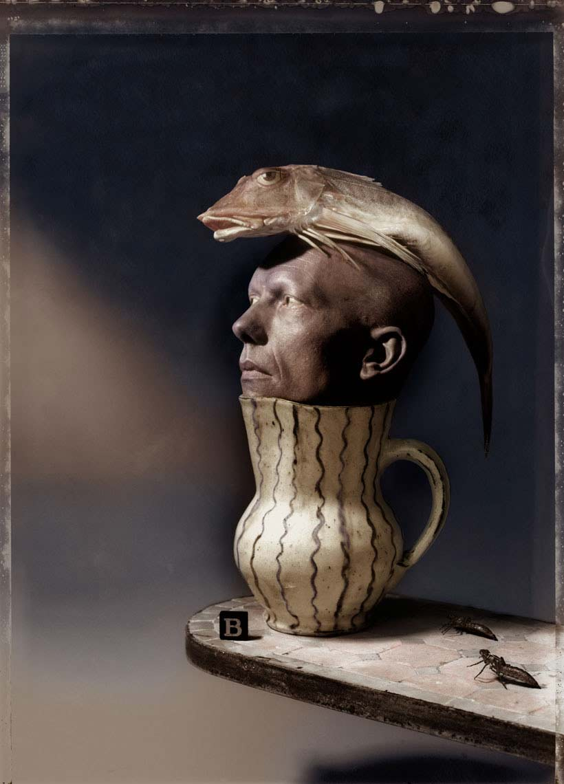 Man in jug with fish on his head